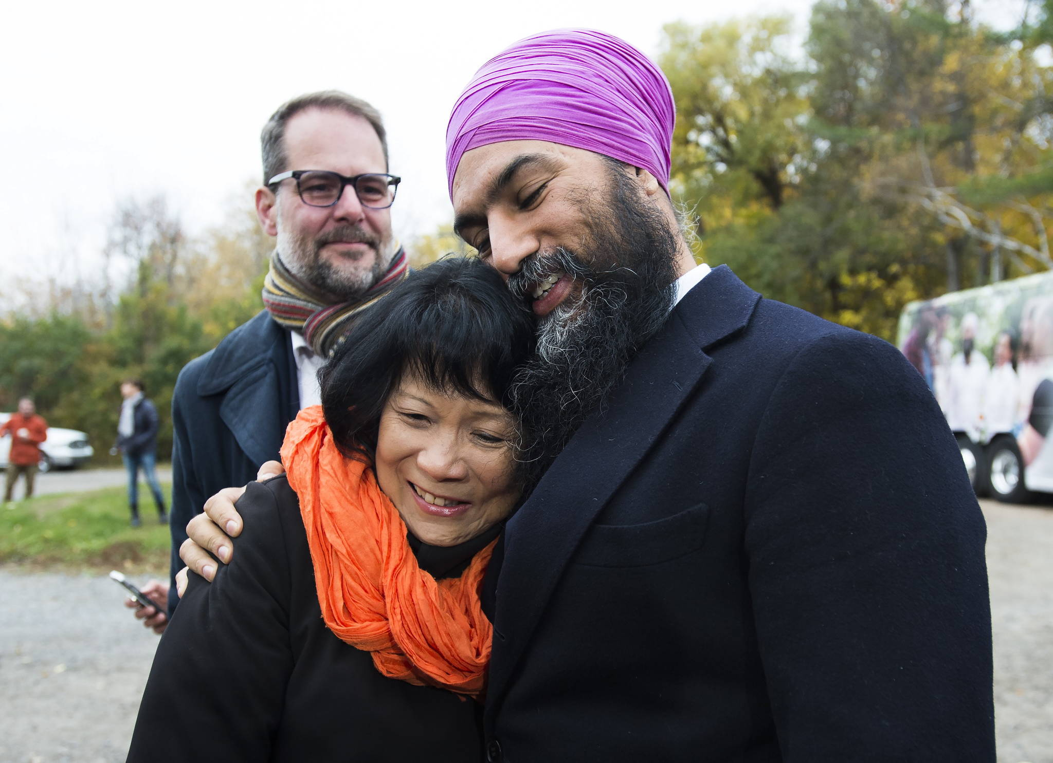 NDP leader Jagmeet Singh, hugs Olivia Chow, widow of former NDP leader Jack Layton as they make an announcement at Jack Layton Park during a campaign stop in Hudson, Que., on Wednesday, October 16, 2019. THE CANADIAN PRESS/Nathan Denette